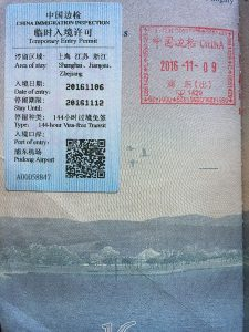 A stamp reflecting a Visa in Transit status within an American passport. One of the options for how you can visit China without a visa before you arrive.
