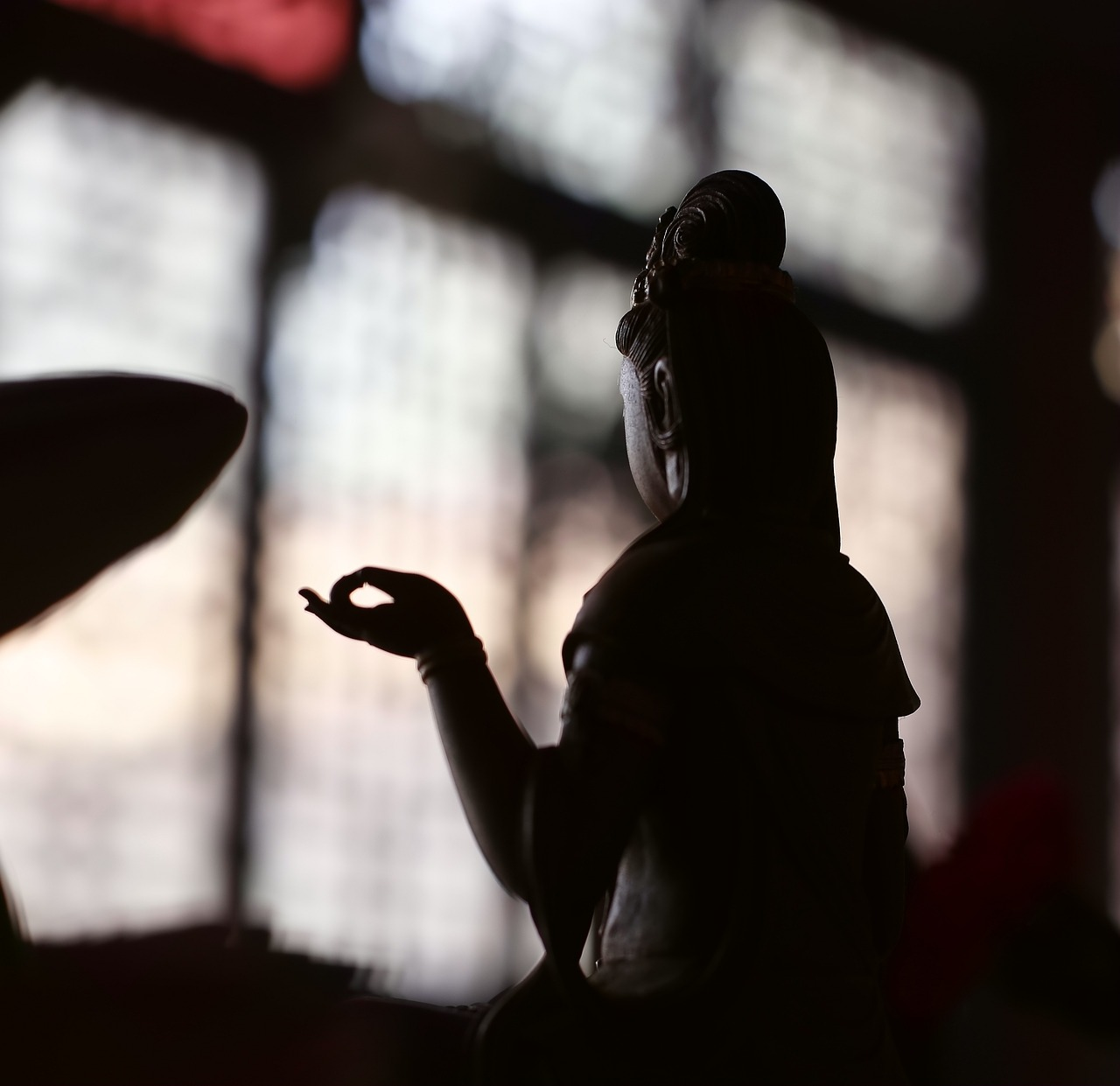 Manjushri in Buddhism is cast as a silhouette.