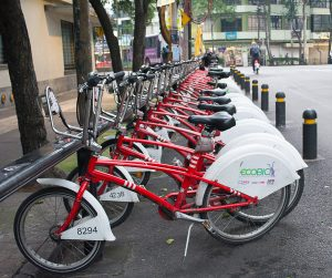 Line of Mexico City Ecobicis parked on a street in La Condesa in Mexico City.