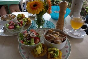 A vegetarian lunch at Parque Arvi in Colombia. Among the pictured food is fried platanos shaped like muffins with avocado on top.