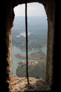 View from inside El Mirador, which leads up to the upper loookout spot in A view of the surrounding lakes an roads below La Piedra del Peñón in Guatapé, Colombia. The lakes are in focus here.