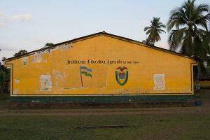 A brightly colored yellow school in El Valle Bahia Solano