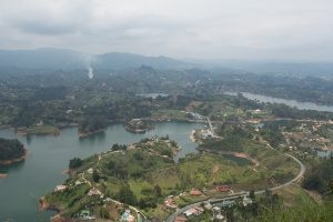 A view of the surrounding lakes an roads below La Piedra del Peñón in Guatapé, Colombia.