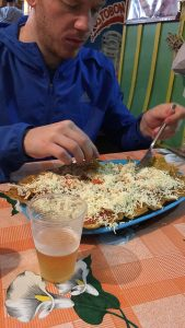Plate of patacones with cheese over top Salento, Colombia